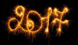 Ano novo feliz - 2017 com os chuveirinhos no preto Imagem de Stock Royalty Free