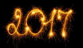 Ano novo feliz - 2017 com os chuveirinhos no preto Foto de Stock Royalty Free