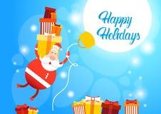 Ano novo feliz do cartão do Feliz Natal de Santa Claus Hold Big Present Box do voo Fotografia de Stock Royalty Free