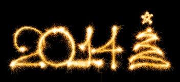 Ano novo feliz - 2014 e a árvore de Natal fizeram um chuveirinho em um bl Fotografia de Stock Royalty Free