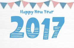 Ano novo feliz 2017 e bandeiras do partido que penduram no backgr de madeira branco Foto de Stock Royalty Free