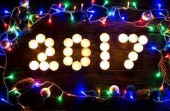 Ano novo feliz 2017 escrito com velas ardentes Imagem de Stock Royalty Free