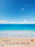 Ano novo feliz 2017 na areia Foto de Stock