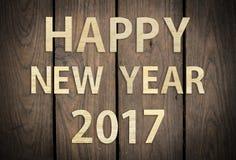 Ano novo feliz 2017 na textura e no fundo de madeira da prancha Imagens de Stock