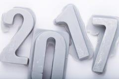 Ano novo feliz 2017 no bacground branco Figuras da mástique ou do engodo Fotografia de Stock Royalty Free