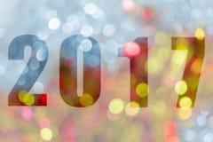 Ano novo feliz 2017 no bokeh abstrato da luz Fotografia de Stock