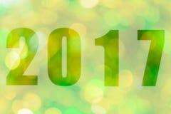 Ano novo feliz 2017 no bokeh abstrato da luz Fotografia de Stock Royalty Free
