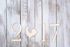 Ano novo feliz 2017 no fundo de madeira Imagens de Stock Royalty Free