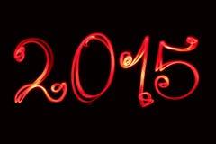Ano novo feliz que cumprimenta 2015 escrito pela luz vermelha Fotografia de Stock
