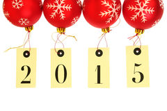 Ano novo 2015 na suspensão das etiquetas Imagens de Stock Royalty Free