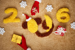 Ano novo 2016 Natal Macaco engraçado com banana Fotografia de Stock Royalty Free