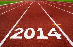 Ano novo 2014 no conceito da pista de atletismo. Imagem de Stock Royalty Free