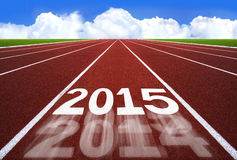 Ano novo 2015 no conceito da pista de atletismo com céu azul Fotos de Stock