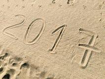 Ano 2017 tirado na areia Fotografia de Stock Royalty Free