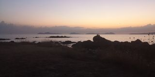 Praia da Fonte with Cies islands on the background, Vigo, after sunset, dusk royalty free stock photo
