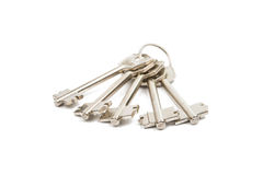 Anodized metal keys. On a white background Royalty Free Stock Photo