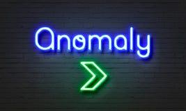 Anomalia neonowy znak na ściana z cegieł tle zdjęcie royalty free