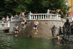 Anomalous heatwave in Moscow. Teenagers cool off in fountains on Manezh Square by the Kremlin during a anomalous heatwave in Moscow, Russia Stock Image
