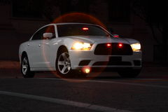 Anonimowy samochód policyjny Przy nocą Zdjęcia Royalty Free