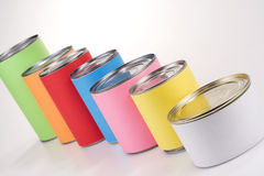 Anonym Colored Cans. A line of colored cans with anonym labels royalty free stock photo