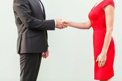 Anonym deal. Handshake, celebrate cooperation. Well dressed business person. Studio shot, gray background stock photos