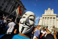 Anonymer Maskenprotest Stockbild
