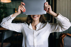 Anonymity in Internet. Modern technology. Electronic purchase, success in e-commerce, business woman hiding face stock photo