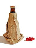 Anonymous. Beer bottle in a brown paper bag isolated on white background Royalty Free Stock Images