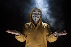 Anonymous activist hacker with mask studio shot. On black stock photography