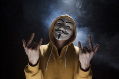 Anonymous activist hacker with mask studio shot. On black stock image