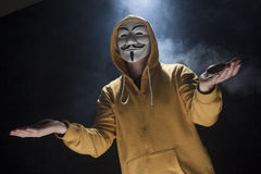 Anonymous activist hacker with mask studio shot. On black stock images