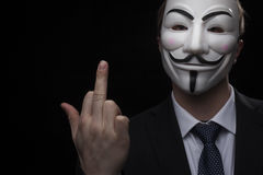 Anonymous activist hacker with mask studio shot. On black royalty free stock image