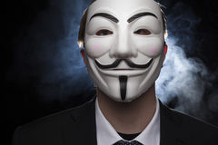 Anonymous activist hacker with mask studio shot. On black stock photos