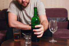 Anonymous alcoholic person hard drinking. Royalty Free Stock Photo