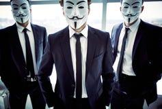 Anonymous attitude. Portrait of three masked guys with attitude stock photos