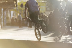 Anonymous biker doing stunts outdoors Stock Photography