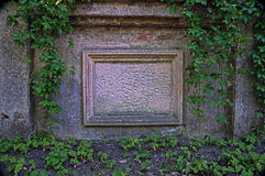 Anonymous blackboard. The photo shows an old tombstone embedded in a brick wall. He is deprived of transcription, is nameless. It is made of sandstone, has a Stock Images