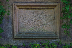 Anonymous blackboard. The photo shows an old tombstone embedded in a brick wall. He is deprived of transcription, is nameless. It is made of sandstone, has a Royalty Free Stock Photo