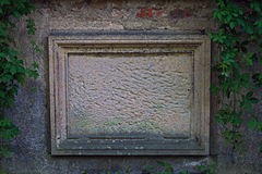 Anonymous blackboard. The photo shows an old tombstone embedded in a brick wall. He is deprived of transcription, is nameless. It is made of sandstone, has a Royalty Free Stock Photography