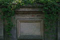 Anonymous blackboard. The photo shows an old tombstone embedded in a brick wall. He is deprived of transcription, is nameless. It is made of sandstone, has a Royalty Free Stock Photos