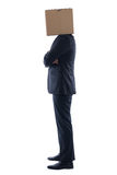 Anonymous business man. With a cardboard box on his head concealing his identity Stock Photography