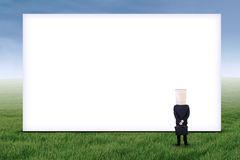Anonymous businessman and empty billboard Royalty Free Stock Photography