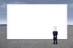 Anonymous businessman and empty billboard 1 Stock Photos