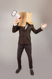Anonymous businessman holding a megaphone Royalty Free Stock Image