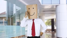 Anonymous worker having good news in office lobby stock footage