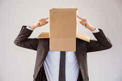Anonymous businessman pointing to box Royalty Free Stock Photo