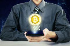 Anonymous businessman showing virtual bitcoin Royalty Free Stock Photo