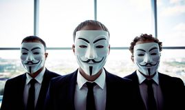 Anonymous businessmen. Portrait of three business people wearing anonymous masks Stock Photography