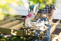 Anonymous Carpenter with Table Saw Stock Photo