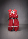 Anonymous children like little santa claus helper. Santa claus little helper in dark background Stock Image